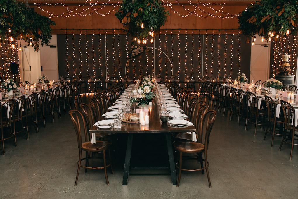 A bright and glowing wet weather wedding reception for a wedding at Osteria.