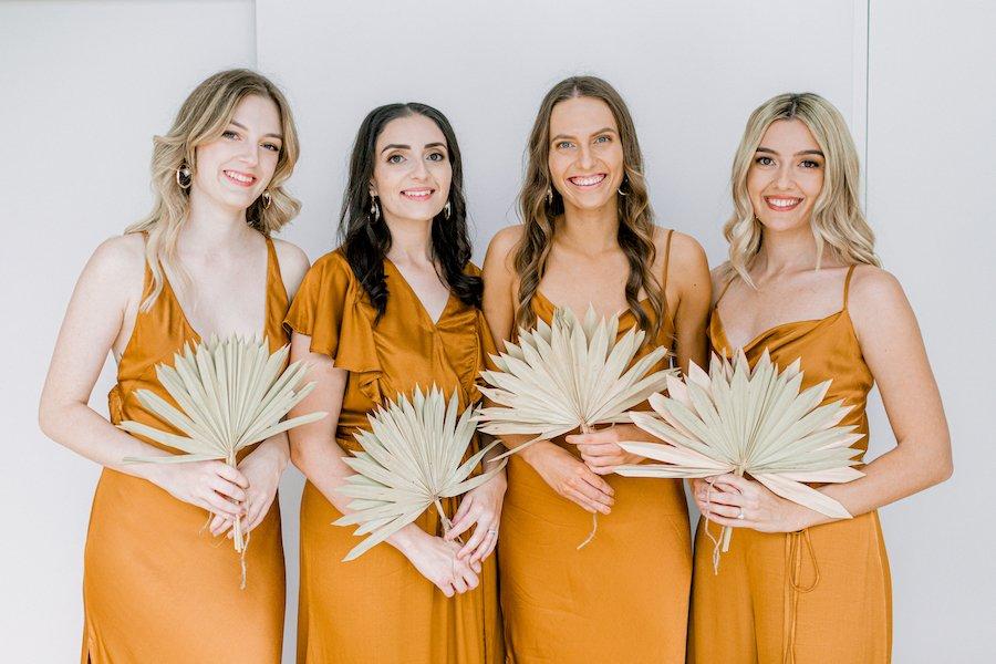 bridesmaid in burnt orange dresses