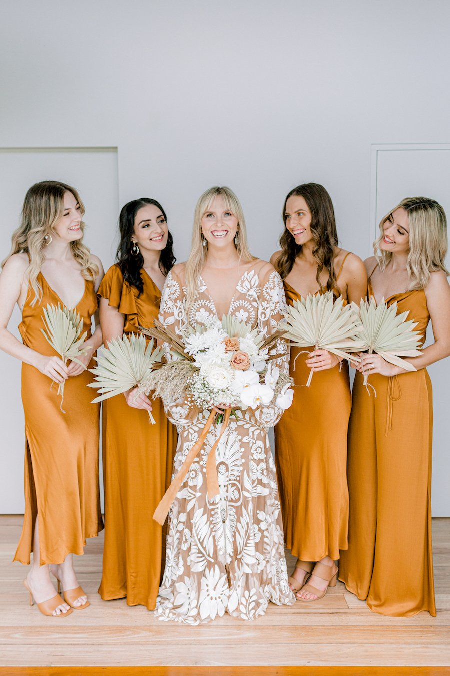 bride with bridesmaid and bouquets