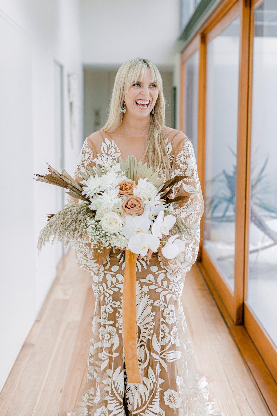 bride holding dried floral bouquet
