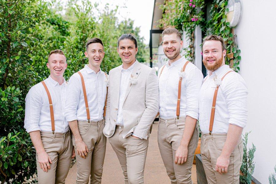 groomsmen in the garden