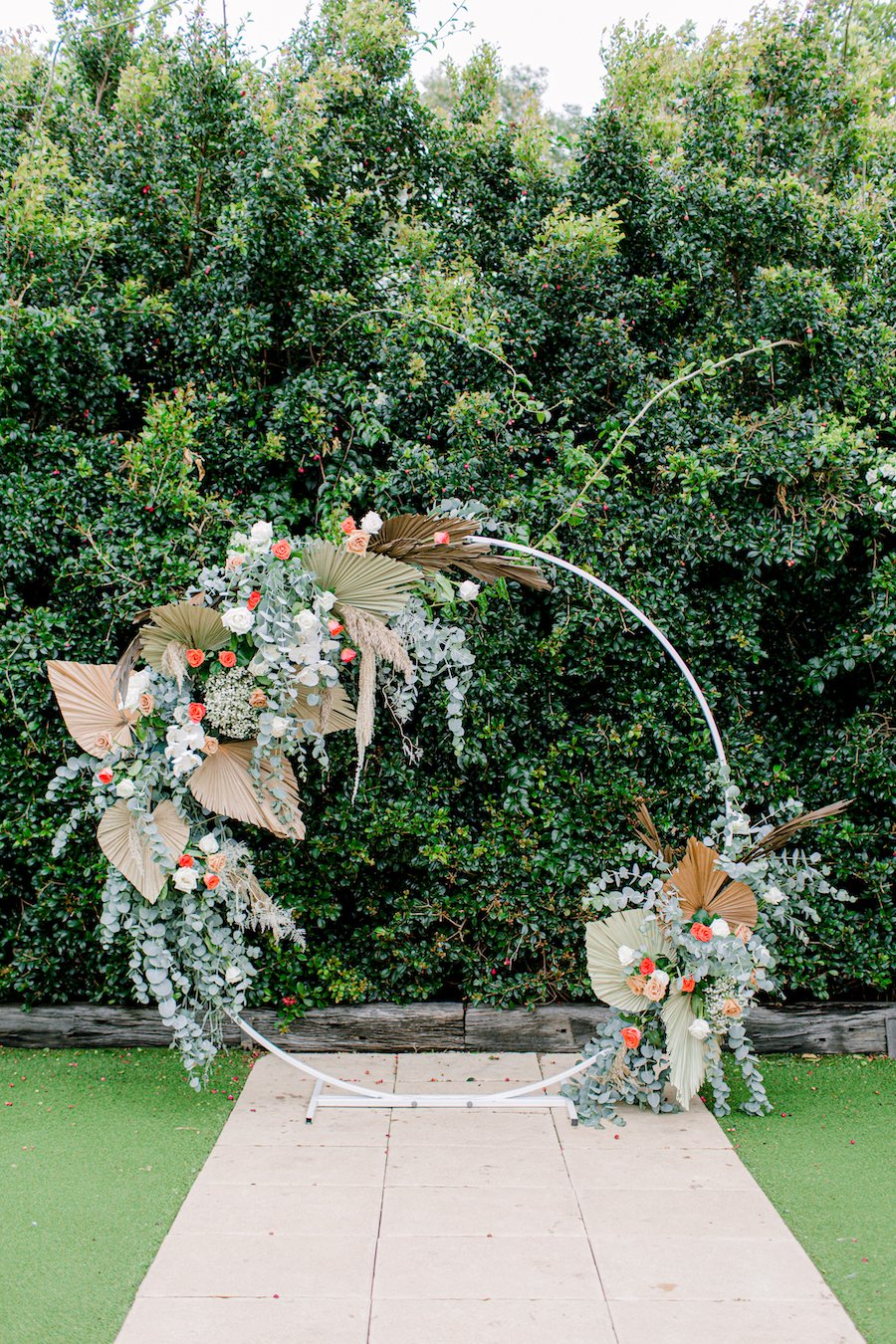 circle white wedding arbour with flowers