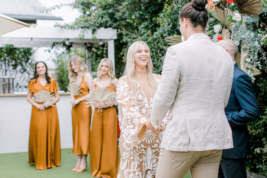 bridal party at weddign ceremony at osteria garden