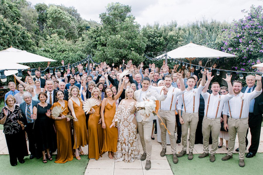 wedding guests with bridal party celebrating in garden