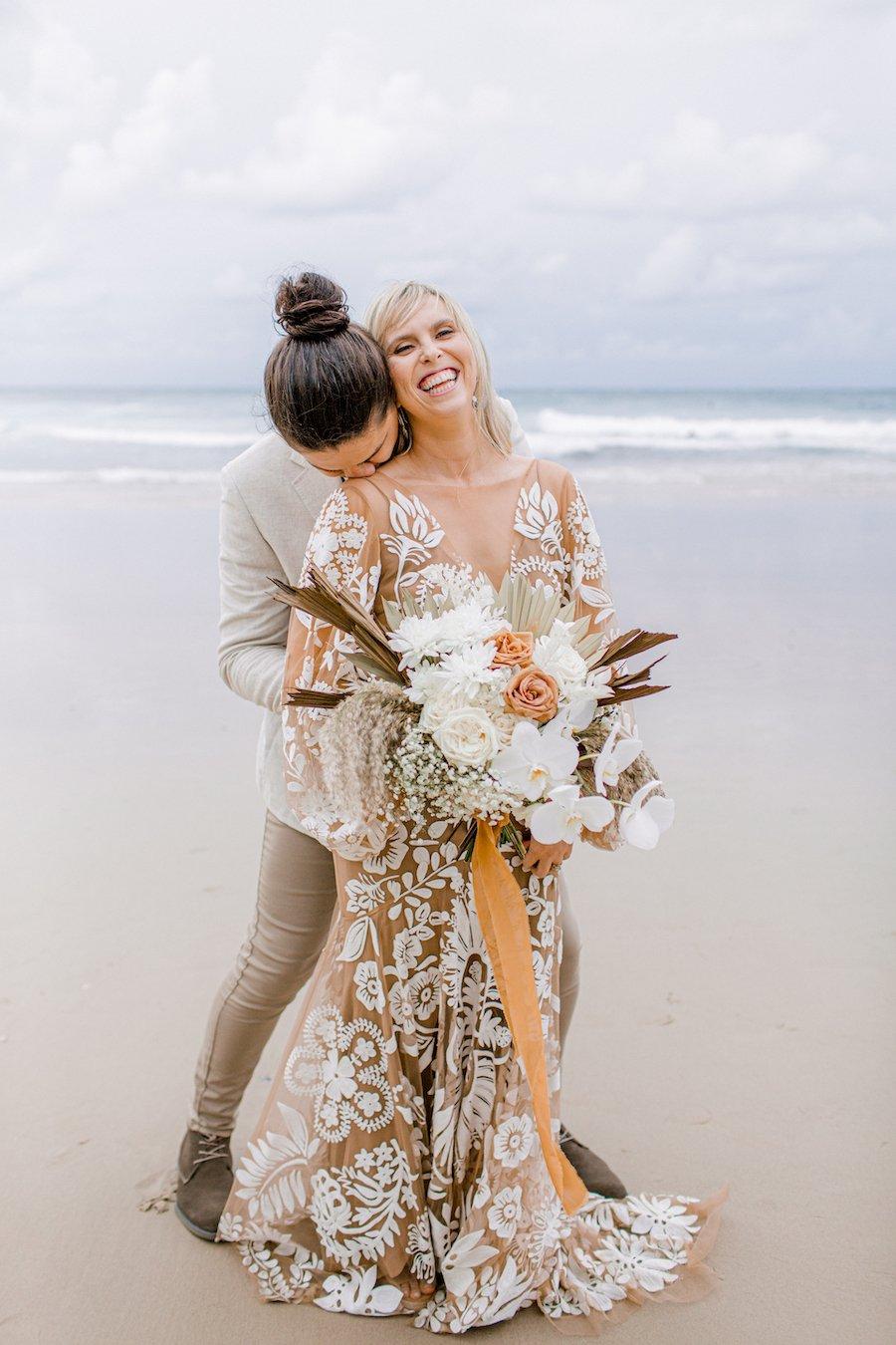 maddy + daniel kissing on the beach
