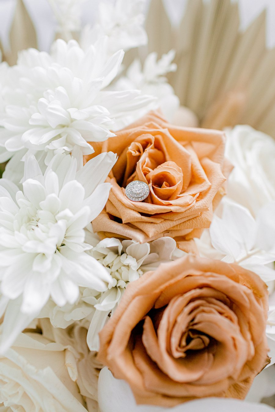 Wedding flowers with engagement ring