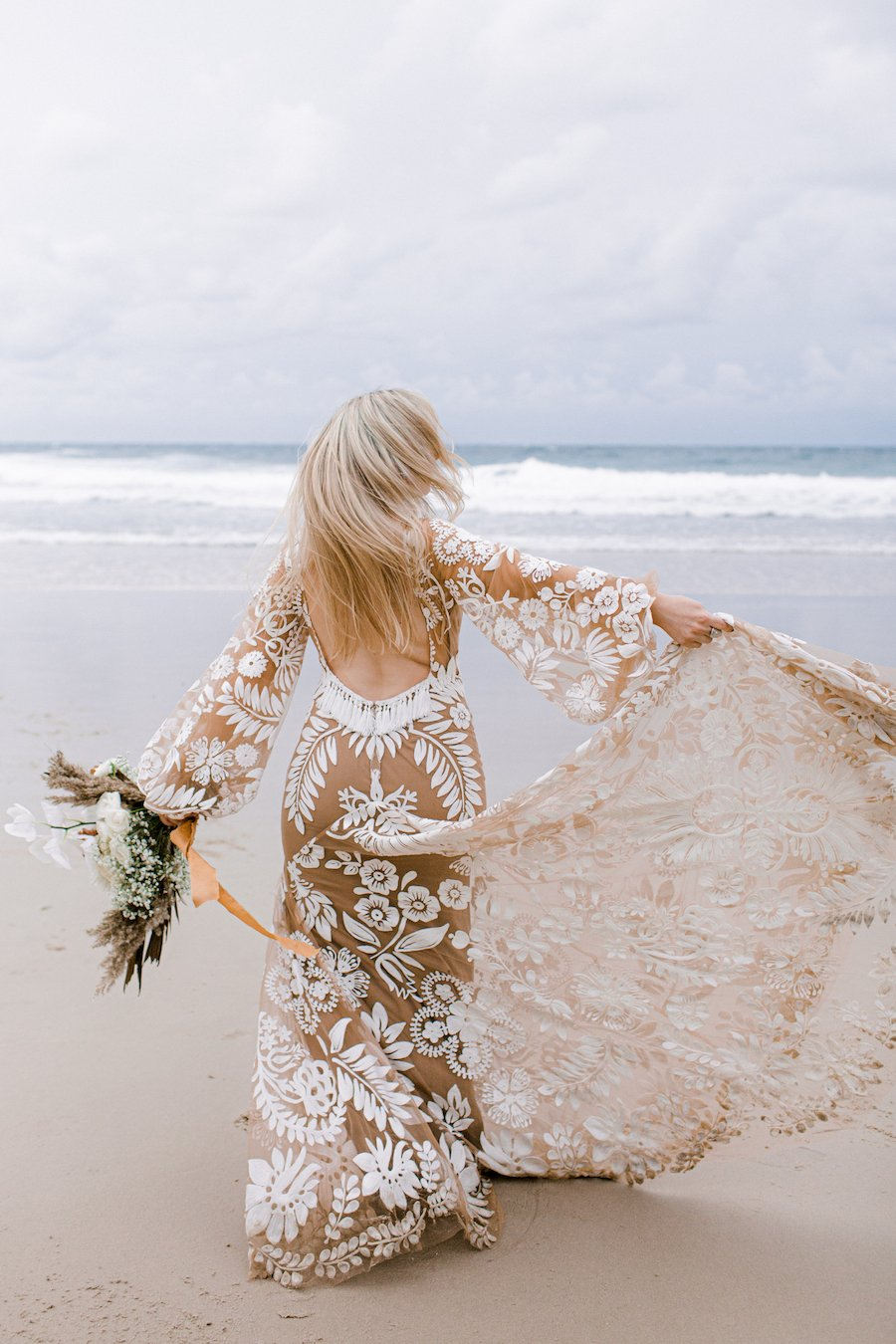 bride dancing on the beach