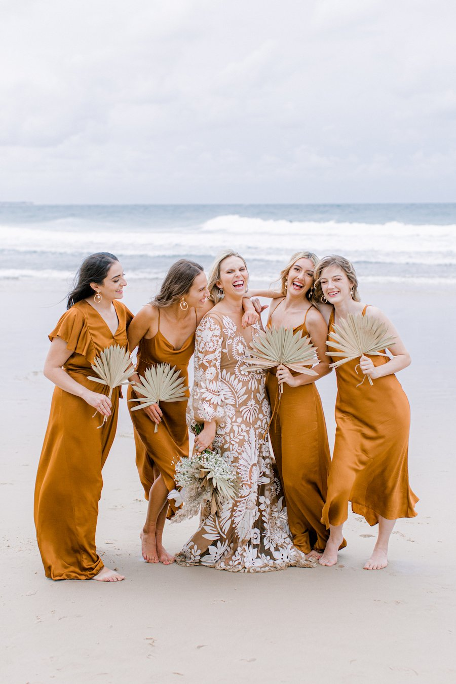 bridesmaid on beach with dried florals
