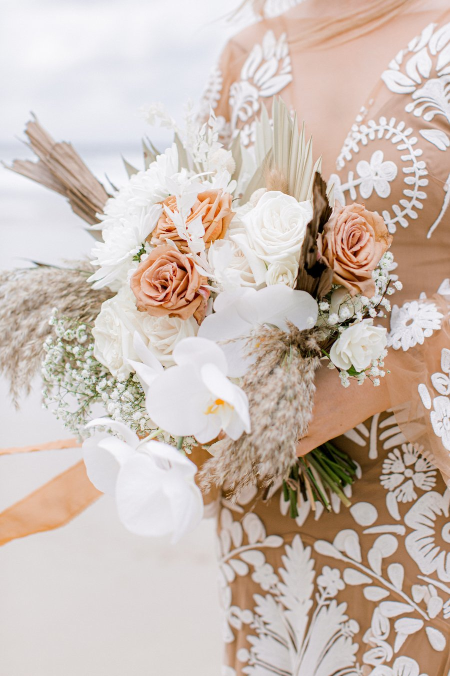 white and peach wedding flowers bouquet