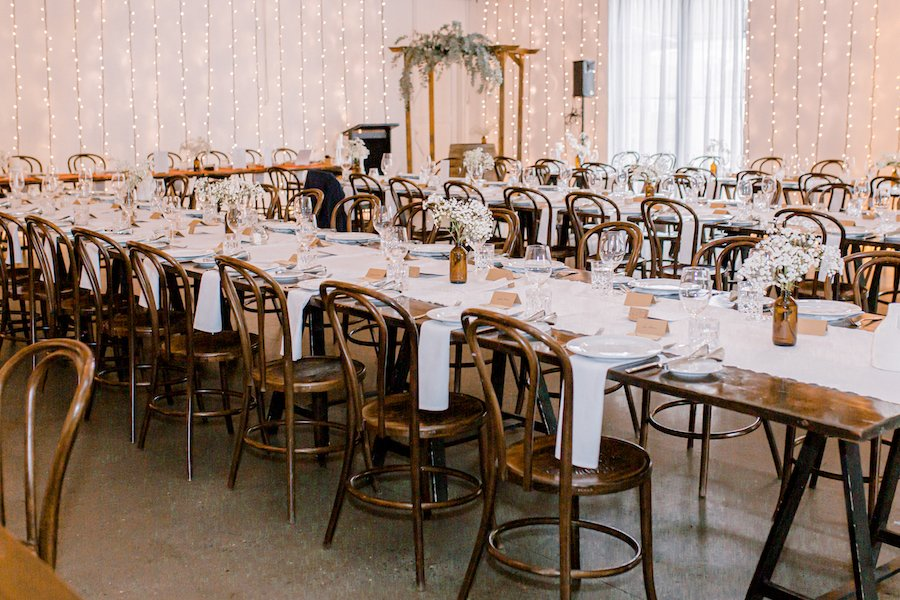 tables and chairs in wedding hall for reception