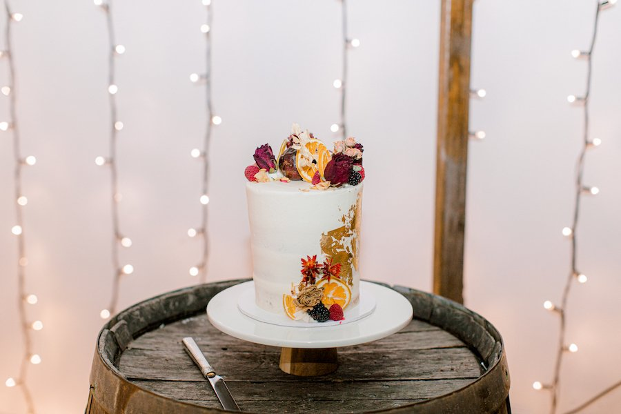 wedding cake with yellow and red flowers