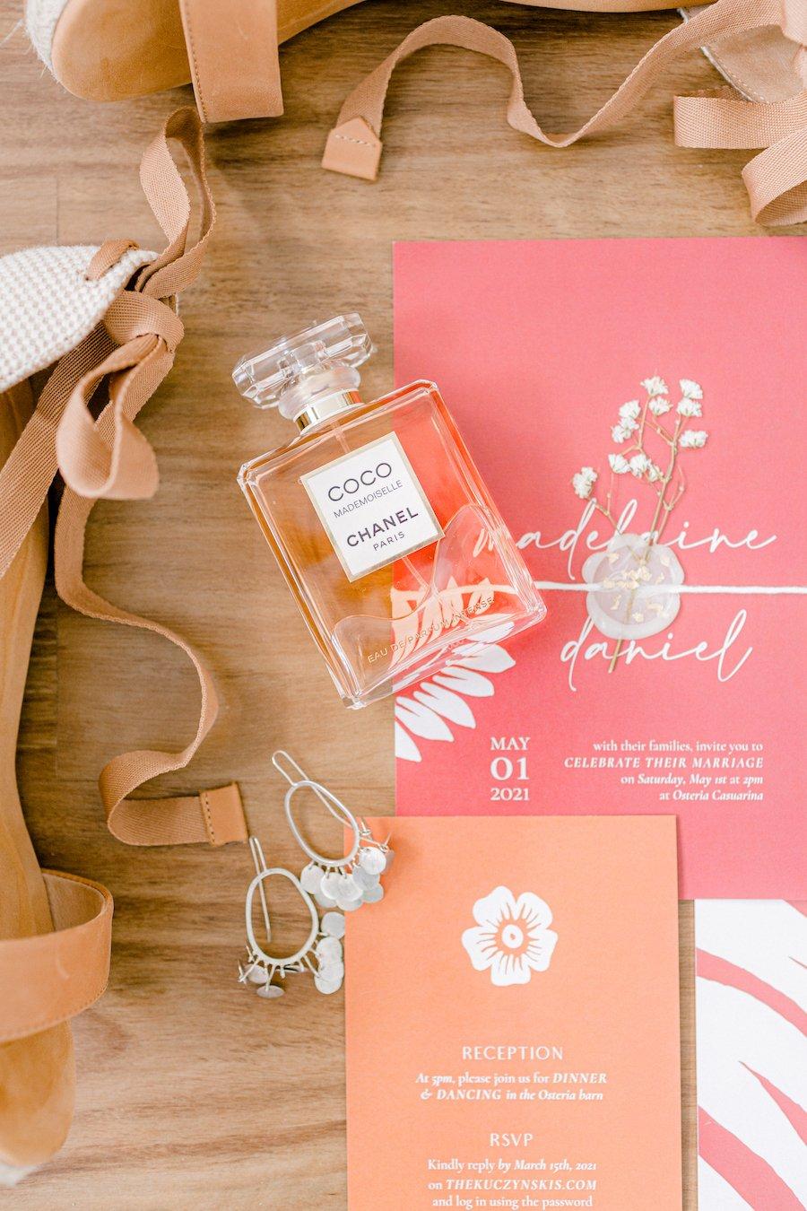 Wedding invitation and perfume